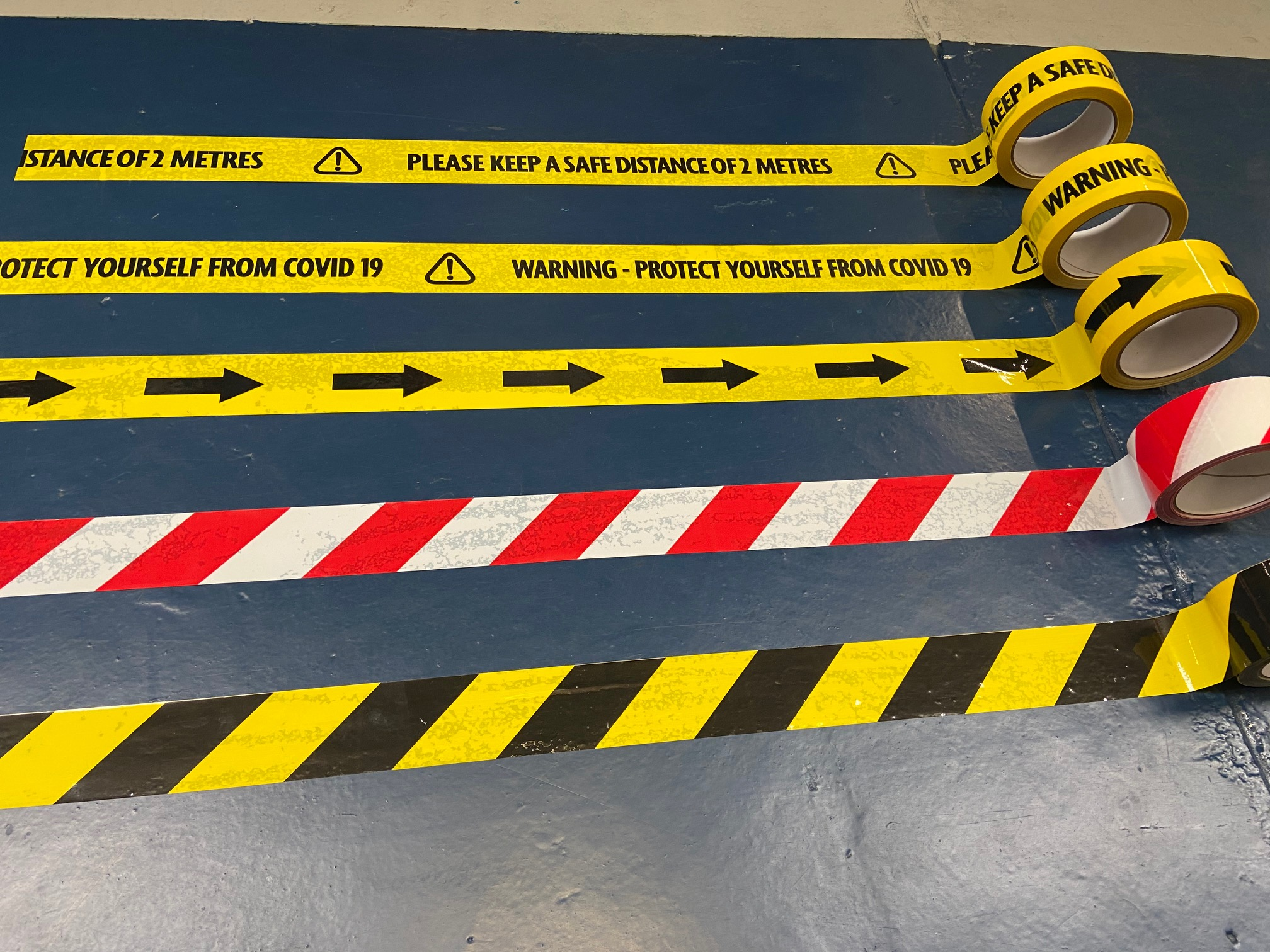 social distancing tape, hazard tape and warning tape